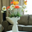 Flowers in a vase on wooden table — Stock Photo
