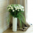 Beautiful white roses in vase — Stock Photo
