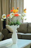 Flowers in a vase on wooden table — Stok fotoğraf