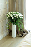 Beautiful white roses in vase — Stok fotoğraf
