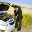Royalty-Free Stock Photo: Lost businessman with car breakdown