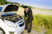 Lost businessman with car breakdown — Stock Photo