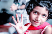 Portrait of  girl child showing palm — Stock Photo