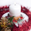 Christmas candle and gold cone. — Stock Photo