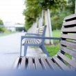 Benches in the green city park. — Stock Photo