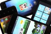 Four mobile phones — Stock Photo