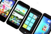 Four smart-phones — Stock Photo