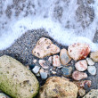 Stones and a wave — Stock Photo