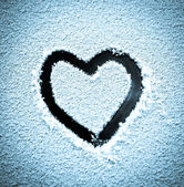 Heart in the snow — Stock Photo