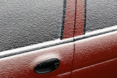 Snowy car door — Stock Photo