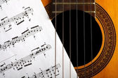Classical guitar and notes — Stock Photo