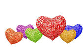 Knitted multicolored hearts family — Stock Photo