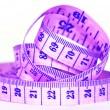Stock Photo: Measuring purple tape