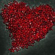 Stock Photo: Heart shape from pomegranate seed's texture