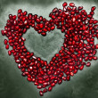 Heart shape copy space from pomegranate seed's — Stockfoto