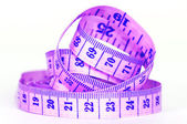 Measuring purple tape — Stock Photo