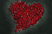 Heart shape from pomegranate seed's texture — Stock Photo
