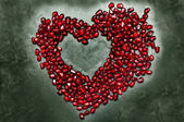 Heart shape copy space from pomegranate seed's — 图库照片