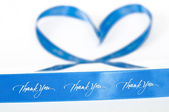 Blue ribbon of gratitude and love — Stock Photo