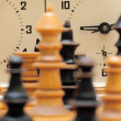 Stock Photo: Chess game figures with clock