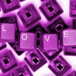 Stock Photo: LOVE pink keys