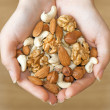 Various nuts in hands — Foto Stock