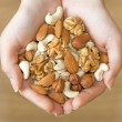 Various nuts in hands — Stockfoto