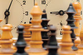 Chess game figures with clock — Stok fotoğraf