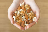 Various nuts in hands — Stock Photo
