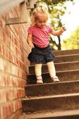 Portrait of a child on the steps — Stock Photo