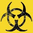 Grunge style biohazard sign, raster version. - Stock Vector