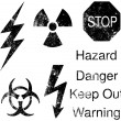 A set of grunge danger and hazard icons — Stock Vector