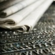 Daily newspaper and movable type — Stock Photo #18271963