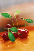 Red cherry with water — Stock Photo