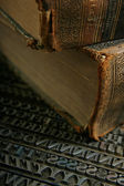 Movable type with old book — Stock Photo