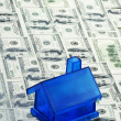 Blue Money House - Stock Photo