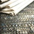 Daily newspaper and movable type - Stock Photo
