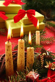 Christmas candle and gifts — Stock Photo