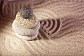 Three stones in the sand — Stock Photo