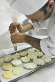 Chef decoring some pastry cream in a baking tin — Stock Photo