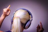 Listening to music dancing girl — Stock Photo
