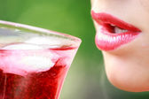 Woman with red lips with a drink — Stock Photo