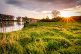 Sunset, river and sun rays — Stock Photo