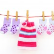 Two pairs baby socks and a cap hanging with clipping path — Stock Photo #18147553