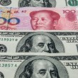 RMB in mid of USD — Stock Photo
