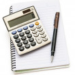 Calculator and pen on note book with clipping path — Stock Photo