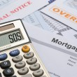 Mortgage and bills-SOS — Stock Photo