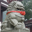 Stock Photo: Fengshui lion with red ribbon