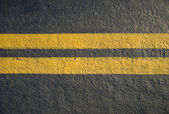 Double yellow lines divider on blacktop — Stock Photo