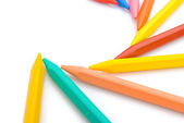 9-color crayon lined up in curved with clipping path — Stock Photo
